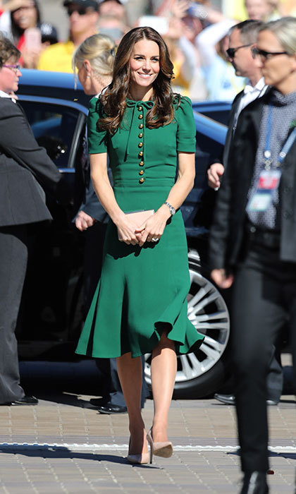 Green was the color for Kate during day four of her Canadian royal tour. The Duchess made a stylish arrival in a bespoke version of the emerald green Pocket watch-appliqué crepe midi dress dress by Dolce & Gabbana while she and William stepped out at the University of British Columbia Okanagan.