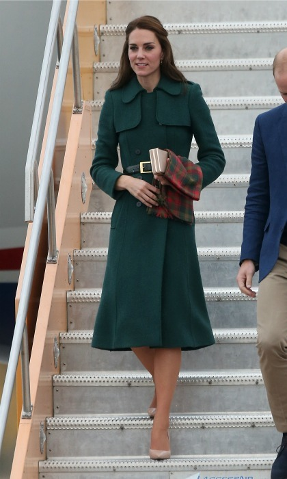 Kate accessorized her green Hobbs coat with tartan during her arrival to the Whitehorse Airport on day four of her and Prince William's Canadian royal tour. 