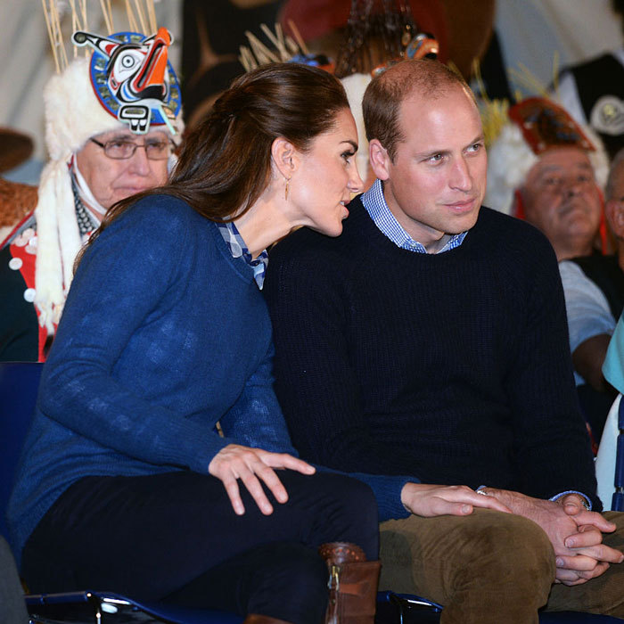 The royal couple kept close with Kate's arm on her husband as they watched a performance from the Bella Bella First Nations Community at Wawiska Community Hall in Canada in 2016. 