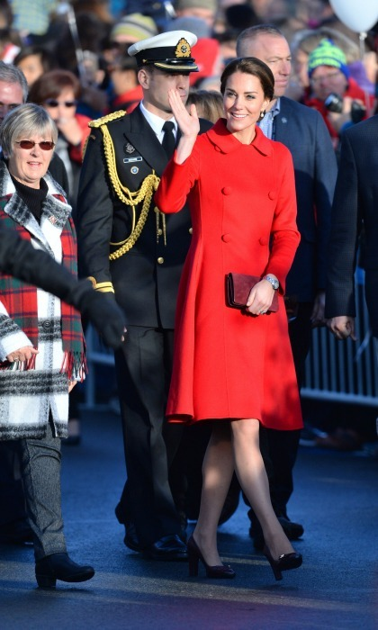 Lady in red! Kate kept it warm and chic in a red Carolina Herrera coat as she made her arrival to the MacBride Museum in Whitehorse. 