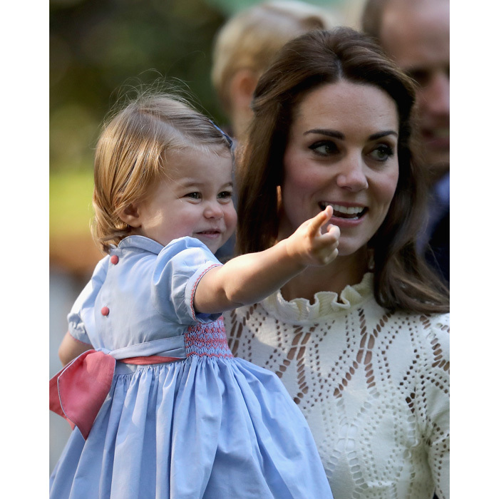 Kate Middleton carried her young daughter into the outdoor party at Government House in Victoria.