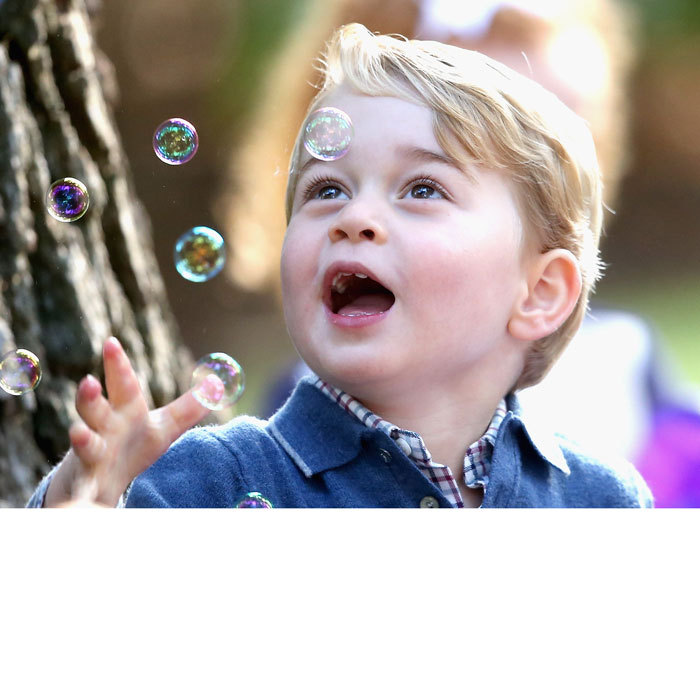Prince George, who got his hands on an orange bubble gun, seemed thoroughly entertained by the bubbles at the party.