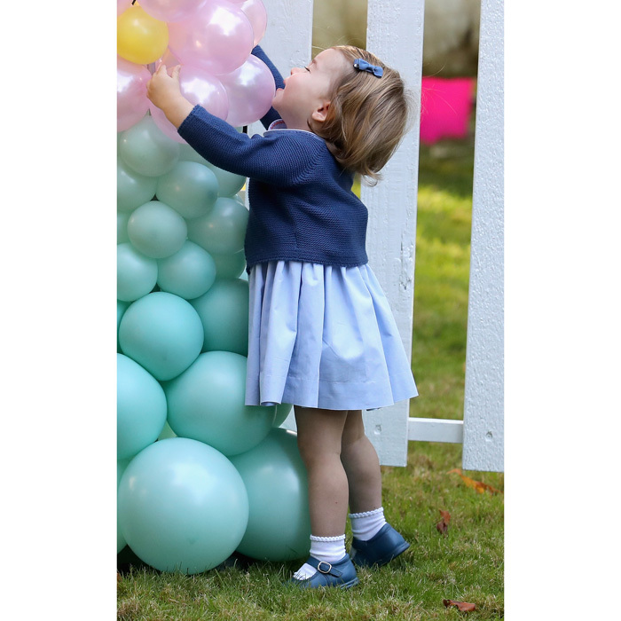 "Prince George's little sister could not get enough of the balloons! Charlotte made a beeline to the balloon archway after being placed on the ground by her mom. The Princess was heard saying, ""Pop!"" as she played with the colorful balloons. George's little sister also attempted to lift the arch much to her parents' amusement.