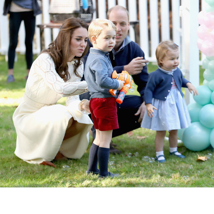 Charlotte and Prince William had bubbles squirted at them by Prince George, who got his hands on an orange Nemo bubble gun.
