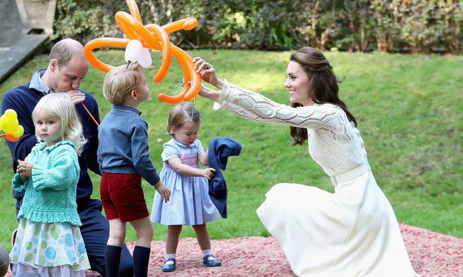 Kate and William joined their children on a blanket for some balloon fun at the children's party.