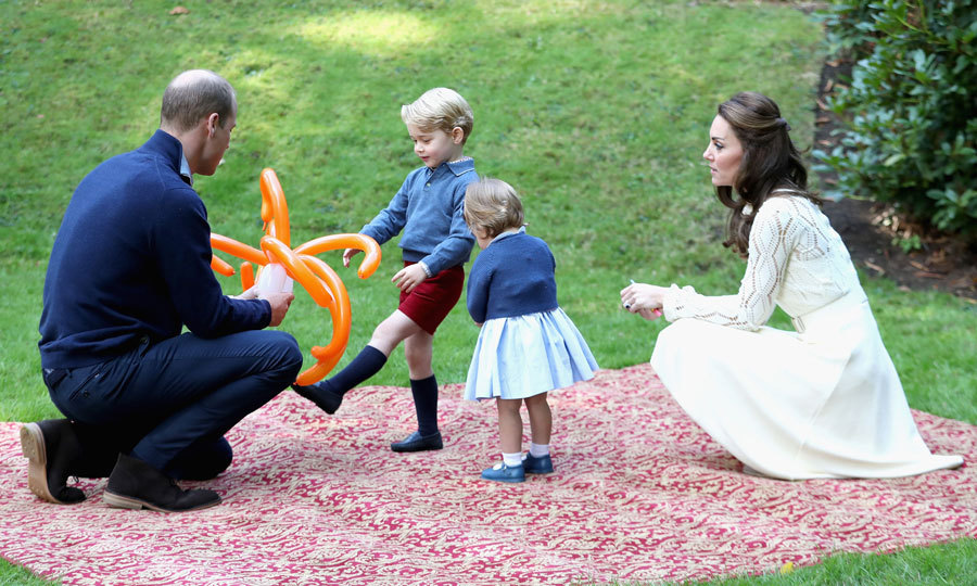 The royal tots were joined by their parents for playtime during a children's party for military families at Victoria's Government House.