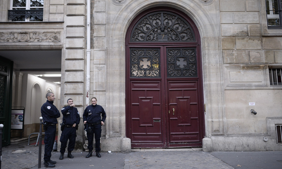 The French Interior Ministry (via CNN) said that five men threatened the building's concierge with a weapon. The criminals then handcuffed him and forced him to open Kim's apartment. Once inside, Kanye's wife was held up at gunpoint.