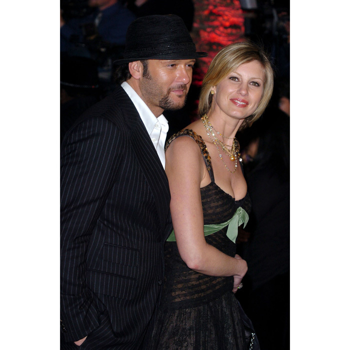 He's with her! Faith Hill tightly held on to her man at the 2004 Vanity Fair Post Oscars Party held at the Mortons in Los Angeles.