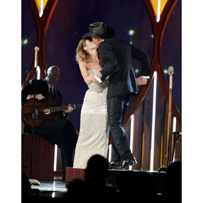 <i>This kiss</i>! The country couple weren't shy when it came to PDA on stage at the 49th annual Academy of Country Music Awards in 2014.