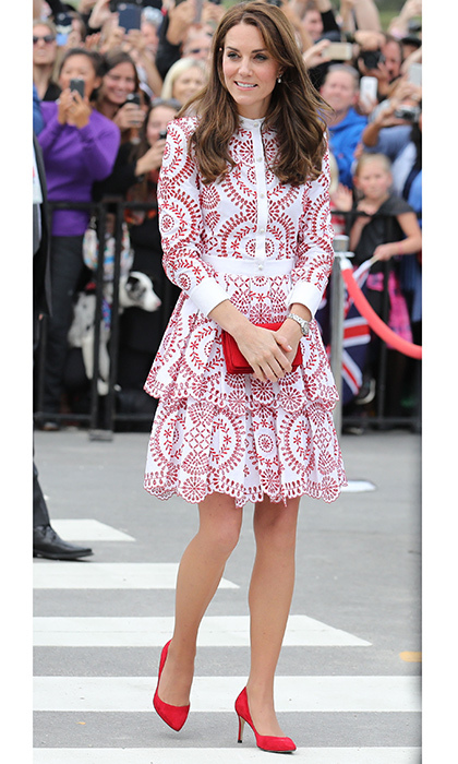 Kate made a fashion forward statement in this white Alexander McQueen dress with crimson details. She accessorized with red heels and a matching clutch for the visit to the Kitsilano Coast Guard Station in Vancouver during the royal tour of Canada. 