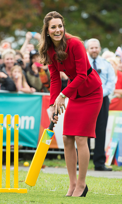 Duchess Kate proves red is a color you can do anything in! Wearing her Luisa Spagnoli suit and high heels, the royal took part in a game of cricket during the 2015 Cricket World Cup in Christchurch, New Zealand.