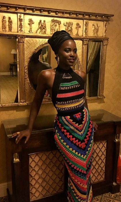 October 2016: Lupita stunned wearing a multi-colored dress from the Balmain Resort 2017 collection for the <i>Queen of Katwe</i> premiere in Johannesburg, South Africa.