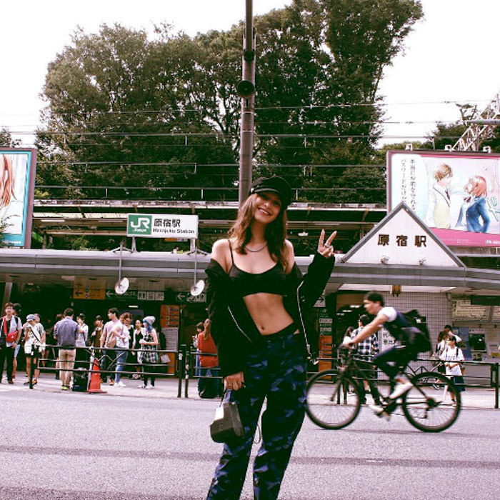 Peace, love, fashion. Bella showed off her edgy street style in the Shibuya ward in Tokyo.