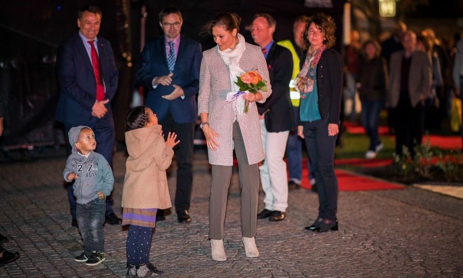 Crown Princess Victoria met with a little visitor during the  20th anniversary celebrations of the Oland Harvest Festival in Borgholm, Sweden. 
