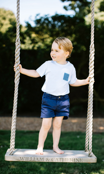 George showed off his off-duty royal style going barefoot in casual portraits for his third birthday. For the occasion, the Duchess of Cambridge's son opted for blue bermuda shorts and a Sunuva 100 percent cotton stripe t-shirt.