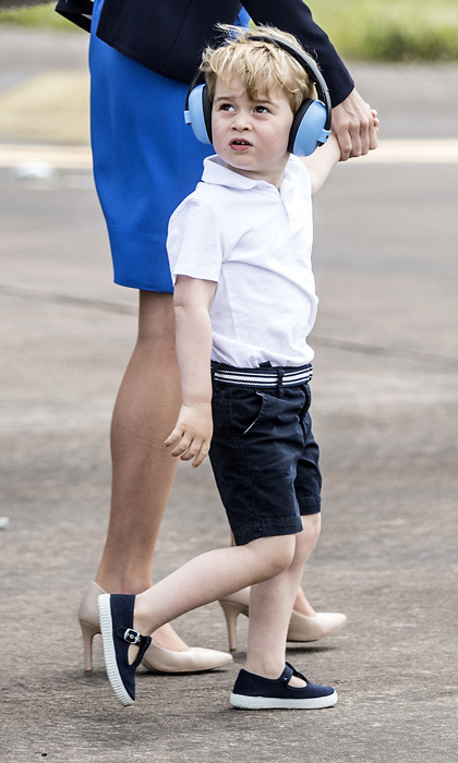 George looked sharp for his first royal engagement on UK soil, sporting a white polo shirt and solid flat front shorts from Gap, which he accessorized with matching shoes.