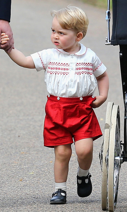 Kate Middleton's son made a statement in red wearing shorts and an embroidered smocked top by the British label Rachel Riley to his sister, Princess Charlotte's christening. 