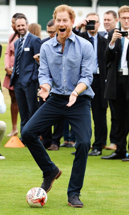 The cheeky royal joined in on soccer fun with the young apprentices before speaking to supporters, plus new participants and graduates of the program.