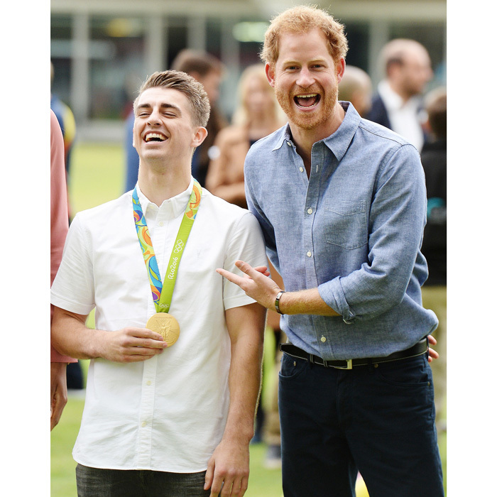While out celebrating the program, Harry met Olympian Max Whitlock, who works as an unofficial ambassador for Coach Core. The athlete wore one of his gold medals around his neck to the event.