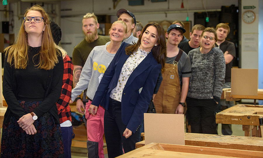 Crown Princess Mary of Denmark leaned in – literally! – as she visited the Teknisk Skole to hear about their implementation of the Mary Foundation's Network program.
