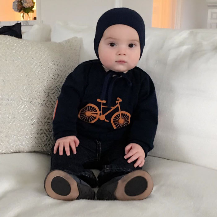 "Fall fashion never looked so cute! Ivanka shared a photo of her baby boy dressed warmly in a black ensemble, which featured an orange bicycle illustration, writing, ""Fall fashion courtesy of Theodore!""