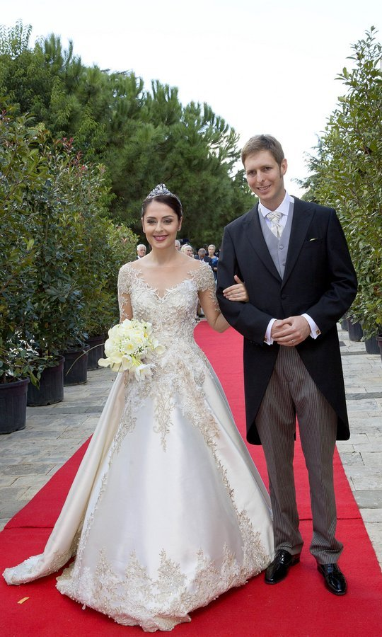 Leka II, Crown Prince of Albania, 34, married actress Elia Zaharia in a ceremony attended by guests including Queen Sofia of Spain. The bride looked like a fairytale princess in an embroidered lace-sleeved gown and delicate tiara for her big day, held at the Palace of Brigades in Tirana, Albania.