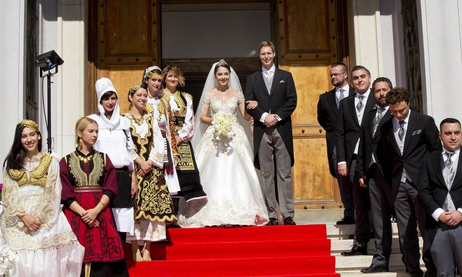 The newlywed Crown Prince – grandson of King Zog I of the Albanians, who was exiled in 1939 – and his Princess posed with the wedding party after the ceremony. 