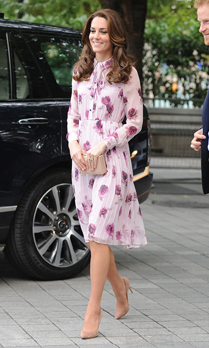 It was a rose printed dress for an English rose. The Duchess of Cambridge stepped out in a new label, Kate Spade for the outing. The chic pink frock features a button up fastening and neck tie detail.
