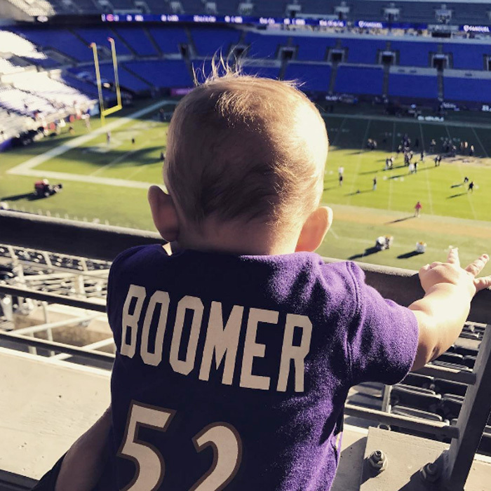 "Boomer Phelps is ready for some football! The adorable son of Olympic swimmer Michael Phelps attentively looked over the M&T Bank Stadium in Baltimore as players practiced. Attached to the photo, a message on Boomer's Instagram read: ""Put me in coach!! I'm ready!! Trust me!! @ravens @raylewis #boomertravels.""