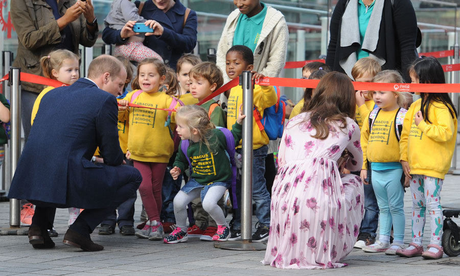 Prince George's parents crouched down to the ground to talk to nursery schoolchildren after going for a ride on the  London Eye.