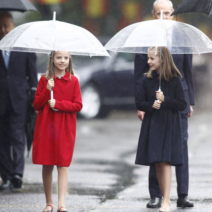 The duo braved the rain in 2016 as they stepped out to attend a military parade on Spain's National Day in Madrid wearing Carolina Herrera coats and matching braids.