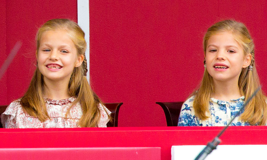 The heir to the Spanish throne flashed a toothy grin alongside her sister Princess Sofia at Spain's 2014 National Day celebrations.  
