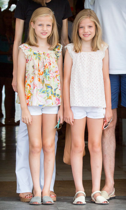 Princess Leonor and Princess Sofia looked stylish in white shorts and frilled blouses on the last day of the 2015 Copa del Rey in Palma de Mallorca.