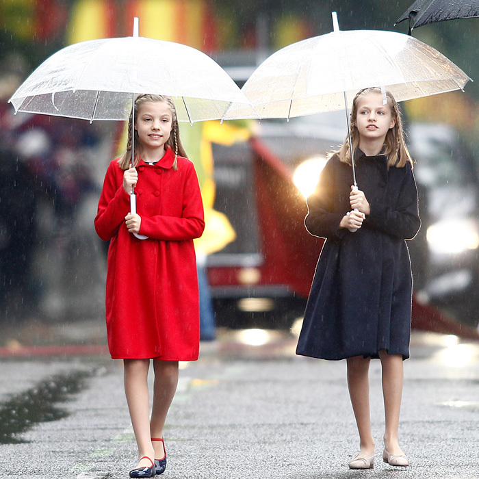 Princess Leonor and Infanta Sofia are following in their stylish mom, Queen Letizia's footsteps. The young royals showed off their fashion credentials wearing Carolina Herrera coats for Spain's National Day celebrations.