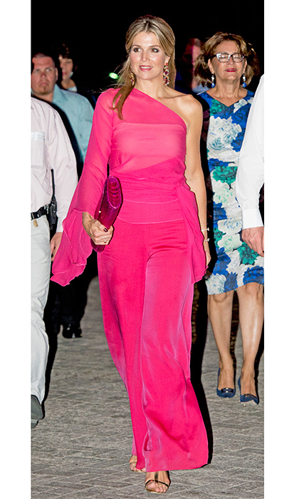 Queen Maxima of the Netherlands was sizzling in a hot pink off-the-shoulder number with a matching clutch for her visit to Aruba.