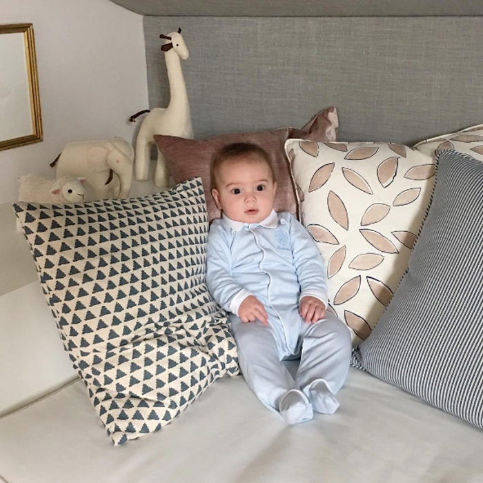 Theo Kushner looked like a little doll wearing a blue romper, while sitting perched up on a pillow-filled couch. Doting mom Ivanka simply captioned the adorable shot with a red heart emoji.