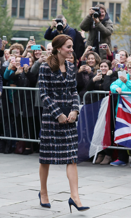 The Duchess of Cambridge continued her style streak, bringing the glamour to Manchester. The mom-of-two stepped out in a navy and pink tweed coat by Erdem, which she paired with her navy suede Rupert Sanderson Malory pumps.