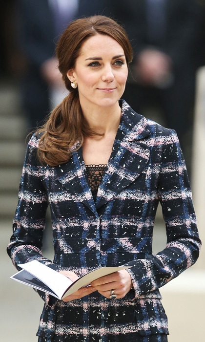 Kate completed her stylish look with a chic twisted, low ponytail and statement pearl earrings.