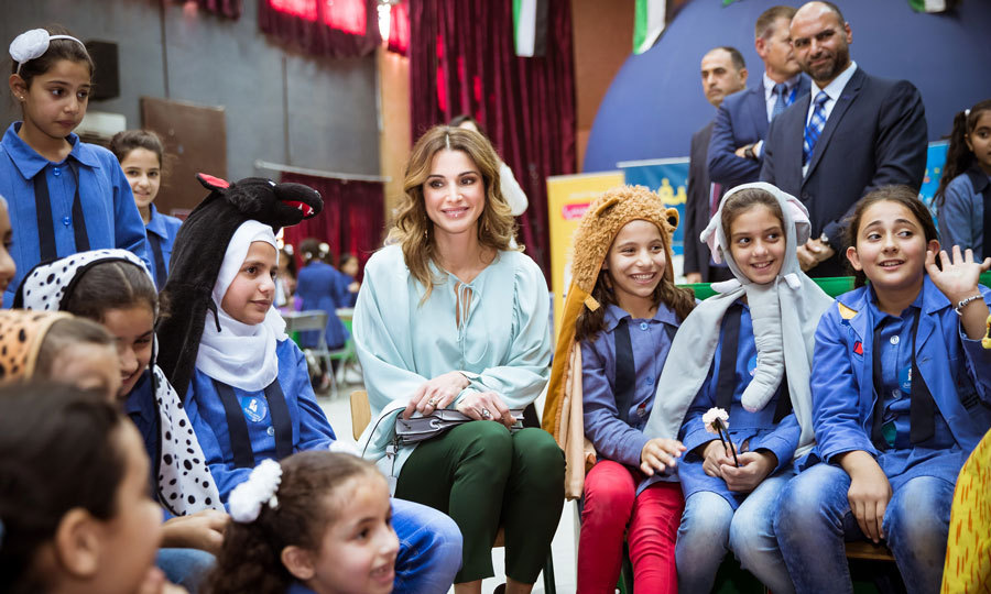 Queen Rania of Jordan couldn't help but smile as she chatted with adorable kids at the Children's Mobile Museum in Al Khansa'a School for Girls in Jerash.
