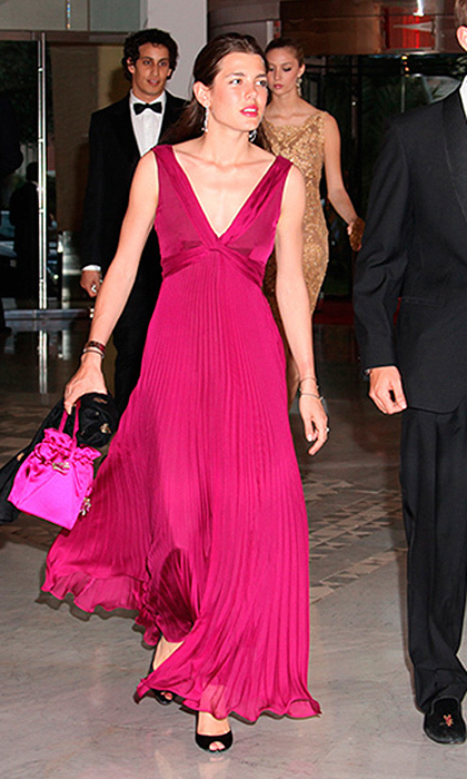 Charlotte Casiraghi donned a deep fuchsia pleated dress with matching bag as she arrived at the Monaco Grand Prix.