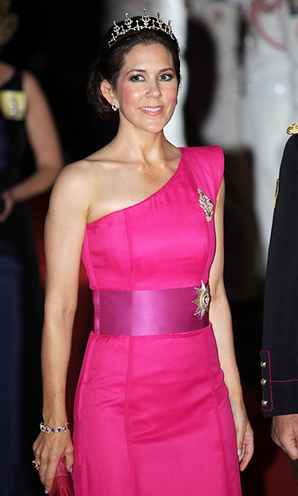 Crown Princess Mary's diamond tiara was the perfect accessory for her one-shouldered gown as she attended the official dinner after the religious wedding of Monaco's Prince Albert and Princess Charlene. 