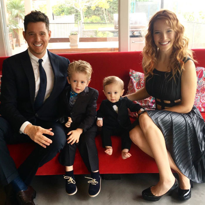 "Michael Buble looked dapper in a suit alongside his smartly dressed sons, Noah and Elias, as he wished his Argentine-born wife, Luisana Lopilato, a happy Mother's Day, celebrated in her country on October 15. Attached to the family portrait, the singer penned, ""#myhero #bestmommy #bestfriend.""