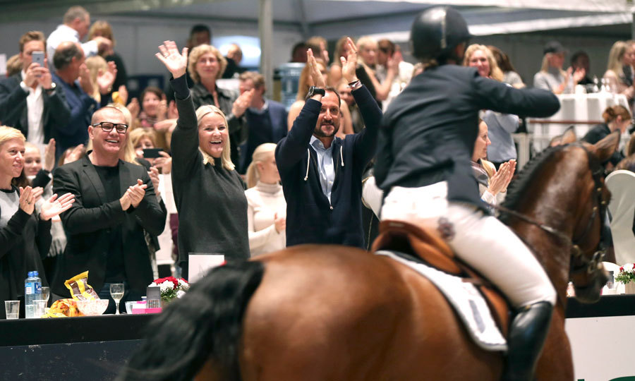 Prior to reuniting with her ex, Martha Louise was supported by her brother Crown Prince Haakon and sister-in-law Crown Princess Mette-Marit, seen with their arms raised in the center of this photo, as she competed in the Oslo Horse Show. The Princess' relatives cheered as she saddled up on her horse.