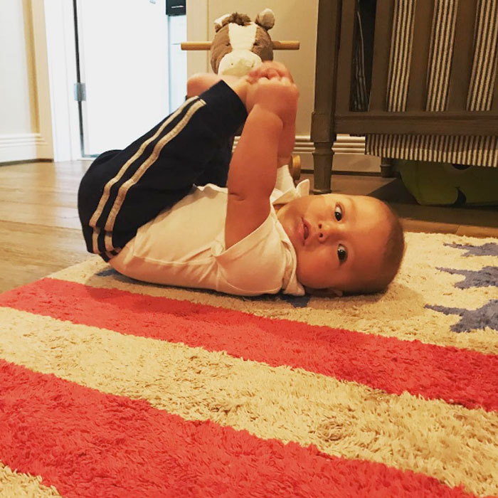 "Michael Phelps' son got in his Saturday stretches. Boomer worked it for the cameras. Attached to the photo a message read: ""Just a little stretching! #saturdaysarefortheboys #footballwithdaddy."" 