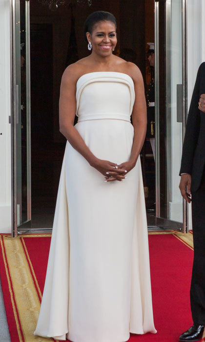 President Barack Obama's wife looked prim and polished donning a strapless crepe ivory gown by Lady Gaga's stylist, Brandon Maxwell, to welcome Singapore's Prime Minister Lee Hsien Loong to their D.C. residence in August 2016.