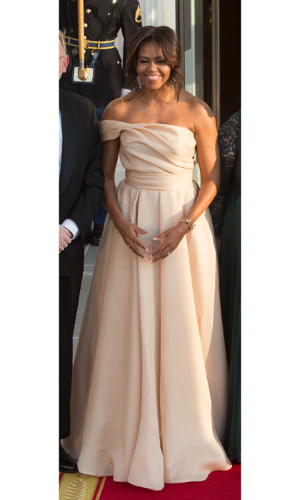 Michelle chose an elegant Naeem Khan blush colored gown, which featured a full skirt and asymmetrical shoulder, for the May 2016 State Dinner welcoming Nordic leaders to the White House.