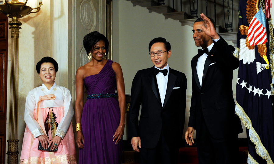 The president's wife stunned in a one-shoulder purple frock by Korean-American fashion designer Doo-Ri Chung to welcome South Korean President Lee Myung-bak and his wife Kim Yoon-ok to their home in October 2011.