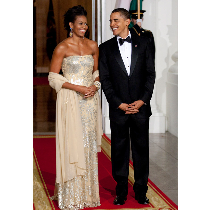 Michelle turned heads at her first White House State Dinner as First Lady of the United States, donning a strapless pastel yellow gown by Indian-American designer Naeem Khan. The stylish piece was a sartorial nod to the president's guests of honor, India's Prime Minister Manmohan Singh and his wife Gursharan Kaur.