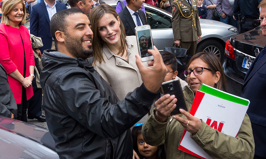 Smile! Queen Letizia snapped selfies with royal fans during a meet and greet as she arrived for a meeting with the Spain Mental Health Confederation in Madrid.