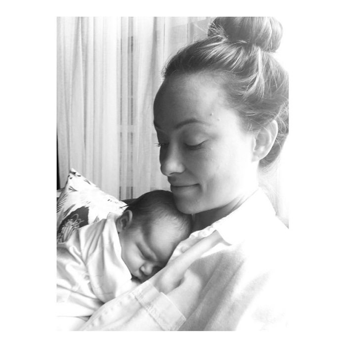 Olivia Wilde sweetly gazed at her daughter, Daisy Josephine Sudeikis, as the newborn slept soundly on the actress' chest.